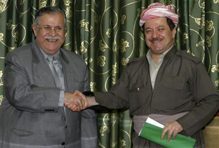 Iraq's President Jalal Talabani (L) shakes hands with Kurdish leader Masoud Barazani after signing an agreement in Arbil, about 350 km (220 miles) north of Baghdad, July 27, 2007. REUTERS/Azad Lashkari