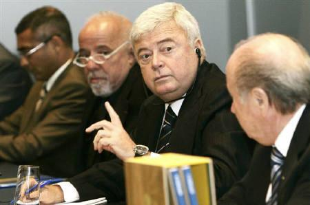 Ricardo Terra Teixeira, President of the Brazilian Football Association, CBF speaks next to FIFA President Josef S. Blatter (R) and Brazil's former national soccer player Romario (L) and Brazil's writer Paulo Coelho during their official bid presentation in Zurich July 31, 2007. REUTERS/Andreas Meier