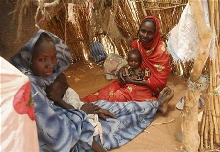 Internally displaced Sudanese women sit inside their make-shift house in a camp near El-Fasher, capital of the north Darfur region, March 25, 2007. The U.N. Security Council was set to authorize up to 26,000 troops and police for Sudan's Darfur region on Tuesday in an effort to quell violence in the vast arid region. REUTERS/Michael Kamber