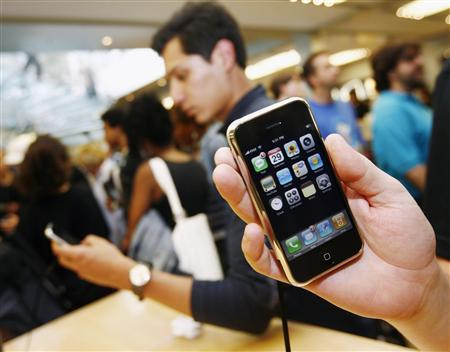 The new iPhone is seen inside the Apple Store in New York, June 29, 2007 file photo. A range of rumors pushed shares in Apple Inc. down more than 3 percent on Tuesday, but there was little consensus about a specific problem for the company, which launched the iPhone last month. REUTERS/Shannon Stapleton
