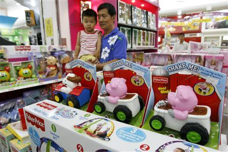 Shoppers walk past Fisher-Price toys at a store in Beijing August 2, 2007. Mattel Inc.'s Fisher-Price unit is recalling about 1.5 million Chinese-made toys around the world, nearly a million of them in the United States, because their paint may contain too much lead. The recall is the latest in a string of incidents that have fueled U.S.-China tensions over the safety of Chinese products. REUTERS/Claro Cortes IV