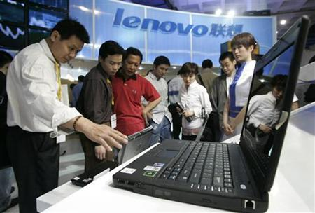 Visitors check Lenovo computers at the '9th China Beijing International High-Tech Expo' in Beijing May 26, 2006. Scandals involving Chinese products in recent months have caused the ''made in China'' label to mean defective, dangerous, and -- in the case of poisoned cough syrup in Panama -- deadly. Fret not, experts say, brands such as PC maker Lenovo Group Ltd. could still capture global market share and become multinationals. REUTERS/Claro Cortes IV