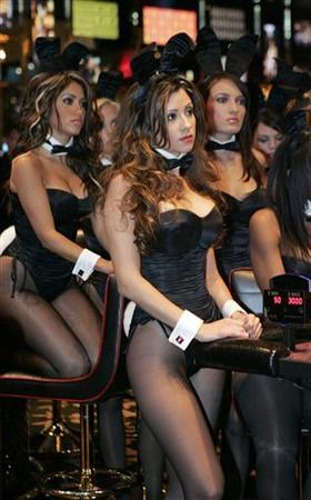 Blackjack dealers are seen at the Playboy Club in Las Vegas, October 5, 2006. Adult entertainment publisher Playboy Enterprises Inc. on Tuesday posted a better-than-expected quarterly results and said it had shored up the performance of its U.S. television business. REUTERS/Steve Marcus
