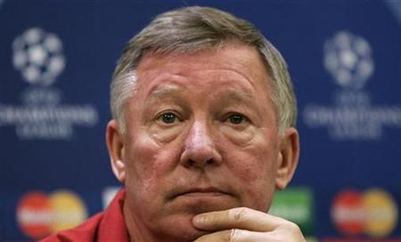 In this file photo Manchester United manager Alex Ferguson listens to a question during a news conference at the team hotel in Milan, Italy May 1, 2007. Ferguson has been ruled out of attending Manchester United's two pre-season friendlies on Wednesday -- by his wife Cathy. REUTERS/Tony Gentile
