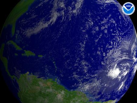 A tropical depression is seen forming over the central Atlantic in an NOAA satellite image taken August 14, 2007. Tropical Storm Dean formed in the Atlantic Ocean, midway between western Africa and the Caribbean Sea, the U.S. National Hurricane Center said Tuesday. REUTERS/NOAA/Handout