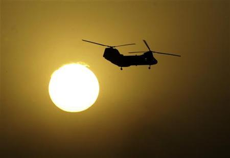 A CH-47 Chinook helicopter in a 2003 file photo. Five U.S. service members were killed when a military transport helicopter crashed during a routine flight west of Baghdad, the U.S. military said. REUTERS/Desmond Boylan
