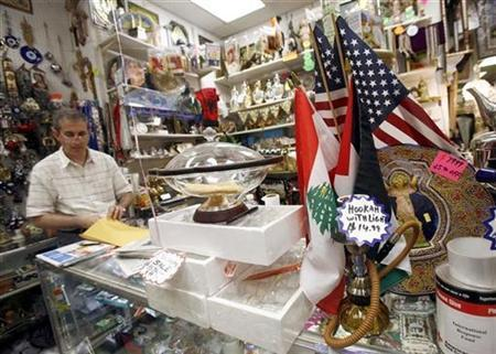 The Lebanese and American flags sit on display among other Middle Eastern items at the Nouri Brothers Shopping Center in Paterson, New Jersey, July 13, 2007. Most U.S. voters think the economy is fair shape, at best, and will grow at a slow pace over the next six months, according to a Reuters/Zogby poll released on Wednesday. REUTERS/Shannon Stapleton