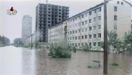 A video grab shows footage of floods from around the country in North Korea August 14, 2007. North Korean authorities have indicated flooding may have left up to 300,000 people homeless, a U.N. aid agency spokesman said on Wednesday, and crop losses may be severe in the impoverished state that has battled famine. REUTERS/KRT Television via Reuters TV