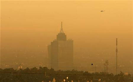 A general view of Mexico City during early morning January 18, 2007. Contaminated air that hangs over the Mexican capital, one of the world's biggest cities, does more damage to children than cigarette smoke and may cause chronic lung diseases when they are adults, a study showed on Wednesday. REUTERS/Daniel Aguilar