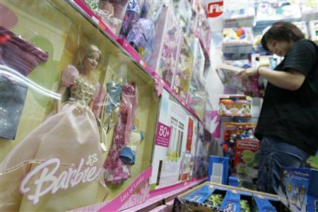 A customer looks at Barbie & Tanner toys at a store in Shanghai, August 15, 2007. REUTERS/Aly Song