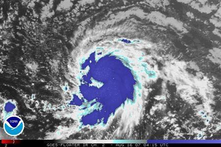 Tropical Storm Dean is seen in a satellite image taken August 16, 2007. REUTERS/NOAA/Handout