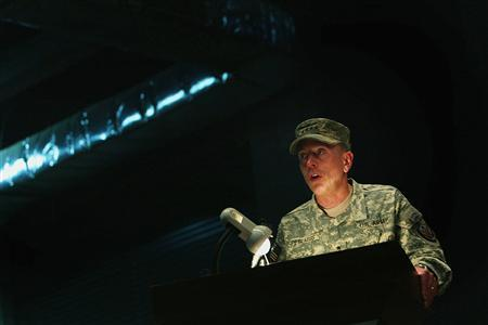 U.S. Army General David H. Petraeus speaks during a Change of Command ceremony in the heavily fortified Green Zone in Baghdad June 10, 2007. A September report on the U.S. troop build-up in Iraq is expected to show a mixed picture of military progress but shortcomings on political reconciliation, triggering a new debate over whether a pullout is warranted. The report due by September 15 from Petraeus, is widely anticipated as a make-or-break assessment of the impact of President George W. Bush's decision early this year to send thousands more troops into Baghdad and Anbar province to try to bring stability. REUTERS/Wathiq Khuzaie/Pool