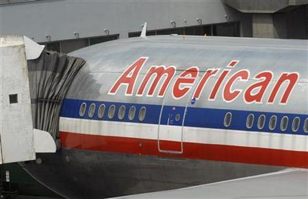 An aircraft from American Airlines sits at JFK International Airport in New York, August 10, 2006. American Airlines, the world's largest airline, said on Friday it was seeking damages from Internet search leader Google Inc for selling search words involving its name. REUTERS/Chip East