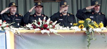 In this file photo head of Iran's Revolutionary Guards Yahya Rahim Safavi (L), Defence Minister Mostafa Mohammad Najjar (2nd L), senior Revolutionary Guard commander Ali Akbar Ahmadian (2nd R) and head of the corps' ground forces Ahmad Kazemi salute Iranian soldiers during a military parade to commemorate the 1980-88 Iran-Iraq war, in Tehran September 22, 2005. REUTERS/Raheb Homavandi