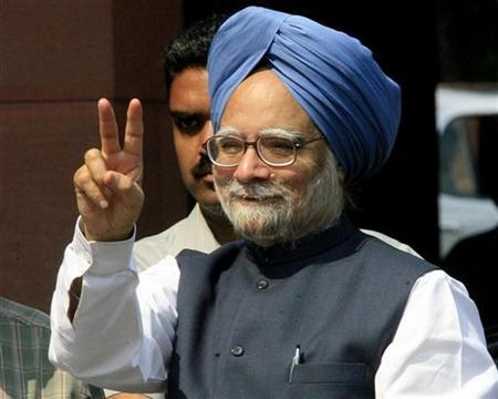 India's Prime Minister Manmohan Singh gestures to the photographers on the opening day of the monsoon session of the Indian parliament in New Delhi August 10, 2007. Singh's government is struggling to weather its worst crisis as communist allies threaten to end support, and even if the coalition scrapes through its stability is likely to be badly dented. REUTERS/B Mathur