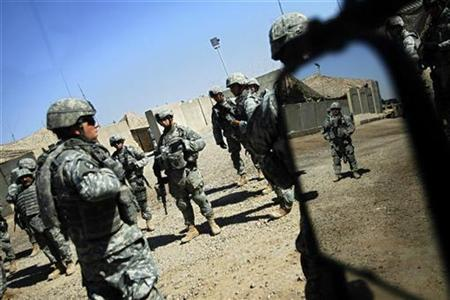 U.S. soldiers from the 2nd battalion, 32nd Field Artillery brigade listen to their superiors' orders before going on a patrol in Baghdad August 14, 2007. U.S. media reporting of the war in Iraq fell sharply in the second quarter of 2007, largely due to a drop in coverage of the Washington-based policy debate, a study released Monday said. REUTERS/Damir Sagolj