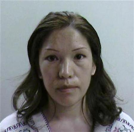 In this booking photo released by Immigration and Customs Enforcement, Elvira Arellano is shown after her arrest in Los Angeles August 19, 2007. Arellano, a Mexican woman whose fight against deportation from the United States became a cause celebre for pro-immigration activists, was deported without her son, the U.S. Immigration and Customs Enforcement said on Monday. REUTERS/Immigration and Customs Enforcement/Handout