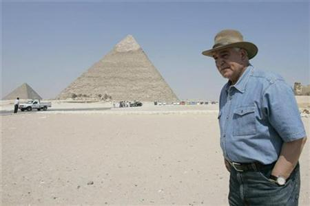 Zahi Hawass, Secretary-General of the Supreme Council of Antiquities, stands near the Pyramids of Giza in Egypt, June 17 2007. Egyptian archaeologists have found what they said could be the oldest human footprint in history in the country's western desert, the Arab country's antiquities' chief said on Monday. REUTERS/Nasser Nuri