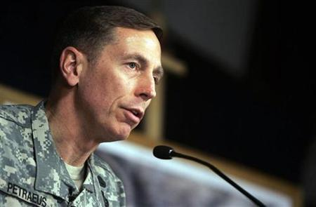 U.S. military commander in Iraq General David Petraeus gestures during a news conference in Baghdad March 8, 2007. U.S. Ambassador to Iraq Ryan Crocker and Petraeus will likely testify to Congress about progress in the war on September 11 or September 12, the White House said on Monday. REUTERS/Chris Hondros/Pool