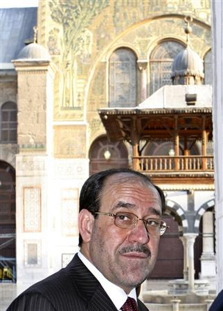 Iraq's Prime Minister Nuri al-Maliki walks during a visit to the historic Umayyad mosque in old Damascus August 20, 2007. REUTERS/ Khaled al-Hariri
