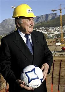 In this file photo FIFA President Sepp Blatter visits the site of Cape Town's Green Point stadium June 19, 2007. Danny Jordaan, chief of the South African event's organising committee, said stadium development was on schedule, sponsorship and TV rights income was already guaranteed to surpass that of 2006 and tourism in the country continued to grow despite one of the world's highest crime rates. REUTERS/Mike Hutchings