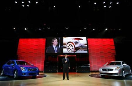 Bill Bosley, Vice President and General Manager of Nissan North America, introduces the 2008 Nissan Sentra SE-R (L) and the 2008 Nissan Altima Coupe at the Los Angeles Auto Show November 29, 2006. If pushing the pedal makes the environmentalist in you cringe, Nissan Motor Co. Ltd. said on Tuesday it will equip all new cars with a device that could help improve fuel efficiency. REUTERS/Max Morse