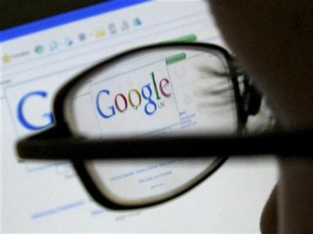 A Google search page is seen through the spectacles of a computer user in Leicester, central England July 20, 2007. Google Inc. is leaning toward bidding in upcoming U.S. mobile phone airwave auctions, despite a partial setback last month from Washington regulators, Chief Executive Eric Schmidt said on Tuesday. REUTERS/Darren Staples