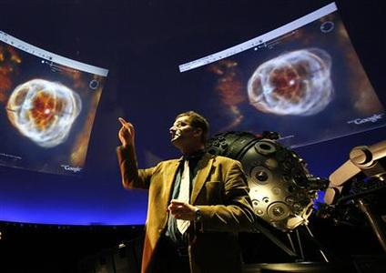 Thomas Krampe, head of the Hamburg planetarium, speaks during a presentation of Google Sky at the planetarium in Hamburg, northern Germany August 22, 2007. REUTERS/Christian Charisius