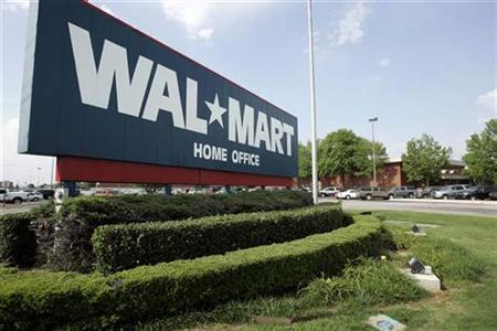 A sign marks Wal-Mart's headquarters in Bentonville, Arkansas June 1, 2007. Wal-Mart Stores Inc. said it pulled two Chinese-made dog treats from its shelves nearly a month earlier, and tests now show they had traces of melamine, a chemical found in pet food that was blamed for the deaths of pets and led to a massive recall earlier this year. REUTERS/Jessica Rinaldi