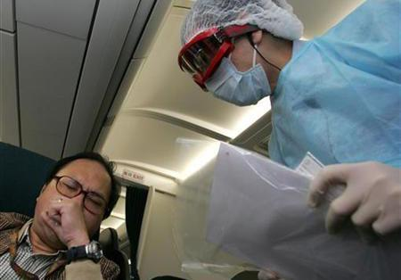 A Hong Kong Health Department doctor (R) wears a protective suit during a simulation exercise held at the Hong Kong International Airport March 17, 2006. Infectious diseases are emerging more quickly around the globe, spreading faster and becoming increasingly difficult to treat, the World Health Organisation (WHO) said on Thursday. REUTERS/Alex Hofford/Pool