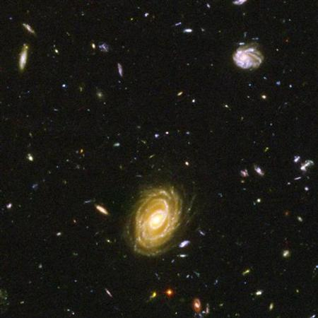 Galaxies in deep space are seen in a 2005 handout photo from NASA. A giant hole in the Universe is devoid of galaxies, stars and even lacks dark matter, astronomers said on Thursday. REUTERS/NASA/Handout