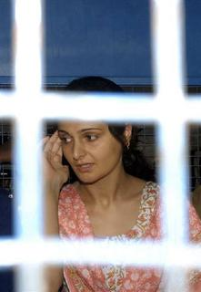 File photo of former actress Monica Bedi arriving at a railway station in Hyderabad, July 18, 2007. REUTERS/Krishnendu Halder