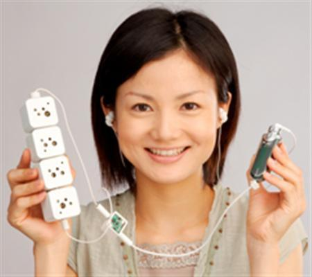 A model displays Sony's bio batteries (L) in an undated handout photo. Sony has developed an environmentally-friendly prototype battery that runs on sugars and that can generate enough electricity to power a music player and a pair of speakers, the Japanese company said. REUTERS/Sony Corporation/Handout