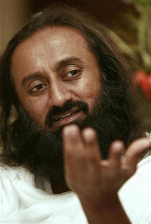 Sri Sri Ravi Shankar speaks with Reuters during an interview at a hotel in Manila, April 27, 2007. An Indian spiritual guru is teaching yoga and meditation to a group of war-weary Iraqis, whom he hopes will extend their new-found inner peace to their nation. REUTERS/Darren Whiteside