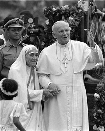 Pope John Paul II holds hands with Mother Teresa in the eastern Indian city of Calcutta in a 1986 photo. A book of letters written by Mother Teresa of Calcutta reveals for the first time that she was deeply tormented about her faith and suffered periods of doubt about God. REUTERS/Luciano Mellace