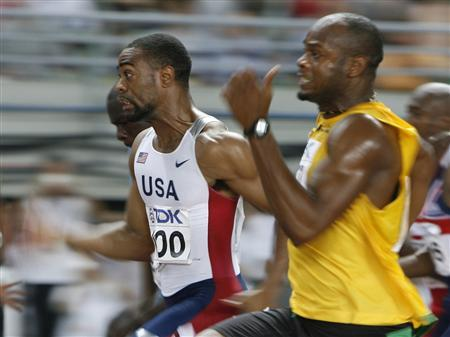 Tyson Gay of the U.S. and Asafa Powell of Jamaica (R) compete in the men's 100 metres final at the 11th IAAF World Athletics Championship in Osaka August 26, 2007. REUTERS/Ruben Sprich