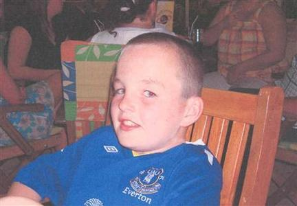 Eleven-year-old Rhys Jones is seen in this undated hanout photo. Four people arrested in connection with the murder of Jones have been released without charge, police said on Monday. Reuters/Police Handout/Merseyside Police