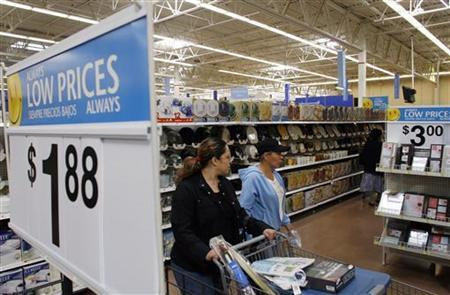 Customers shop at a Wal-Mart in Chicago, September 27, 2006. Wal-Mart is considering acquisitions in its home market as it seeks to open smaller stores and limit its reliance on giant supercenters for growth, the Financial Times reported in its online edition. REUTERS/Joshua Lott