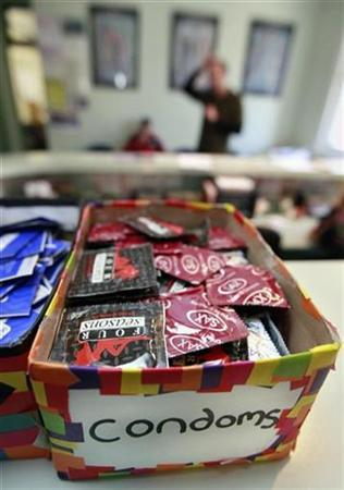 Condoms sit in a box on the front counter of a clinic offering treatment to HIV-positive and 'at risk' people in Sydney July 25, 2007. South Africa's health department said Tuesday it has recalled 20 million potentially defective condoms approved by an official accused of taking bribes from a manufacturer. REUTERS/Tim Wimborne