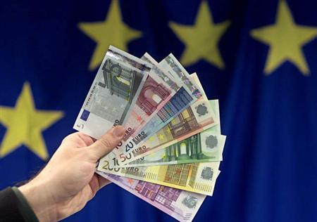 Euro notes are displayed in an undated file photo. A French tax official cheated the government out of 600,000 euros ($820,000) by creating a phantom identity as a university professor and claiming a salary for some 15 years, the government said Monday. REUTERS/Thierry Roge