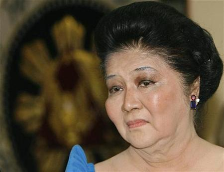 Former Philippine First Lady Imelda Marcos listens to a speaker during the inauguration of the Ferdinand Marcos Library in Manila July 7, 2007. Marcos has asked an anti-graft court to allow her to go to Hong Kong and China for medical treatment and to attend a trade show, her lawyer said on Wednesday. REUTERS/Cheryl Ravelo