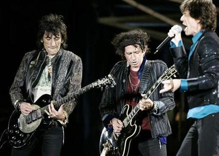 Rolling Stones Ron Wood (L), Keith Richards (C) and Mick Jagger perform during a concert on the band's ''A Bigger Bang'' European tour in Warsaw, July 25,2007. Richards has demanded that two Swedish newspapers apologize to the Rolling Stones and their fans in Sweden for stinging reviews of the band's performance at a concert in Gothenburg. REUTERS/Kacper Pempel