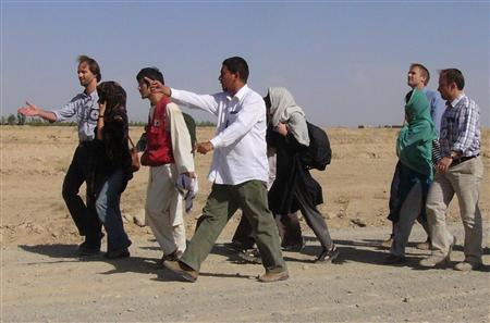 Released South Korean hostages are escorted in the city of Ghazni, August 29, 2007. REUTERS/Shir Mohammad
