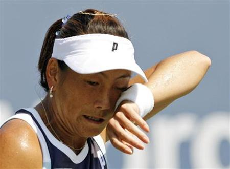Ai Sugiyama of Japan wipes her face during her match against Ekaterina Makarova of Russia at the U.S. Open tennis tournament in Flushing Meadows, New York August 29, 2007. Sugiyama lost the match. REUTERS/Kevin Lamarque