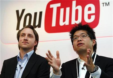 In this file photo Chad Hurley (L) and Steve Chen, co-founders of YouTube pose after a news conference in Paris June 19, 2007. YouTube said on Wednesday that it has reached a deal with British licensing organizations that collect royalties on behalf of 50,000 composers, songwriters and publishers. REUTERS/Philippe Wojazer