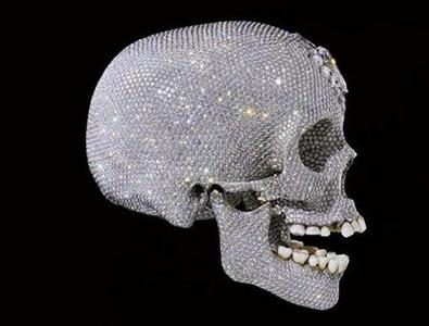 A life size cast of a human skull in platinum by British artist Damien Hirst is seen in this handout image released in London, June 1, 2007.The skull has been sold to an investment group for the asking price of $100 million (50 million pounds), a spokeswoman for Hirst's London gallery White Cube said on Thursday. REUTERS/Prudence Cuming Associates/Handout