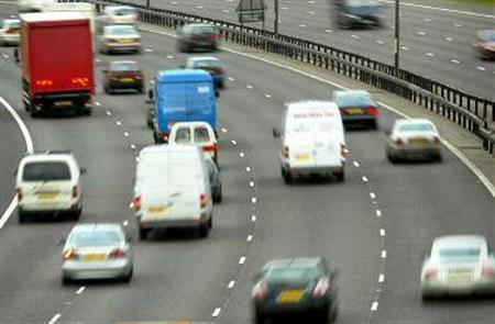 Traffic drives along a motorway in Britain in an undated file photo. A teenager has been arrested on suspicion of having posted a video of himself on YouTube driving at speeds of more than 140 mph, police said on Thursday. REUTERS/File