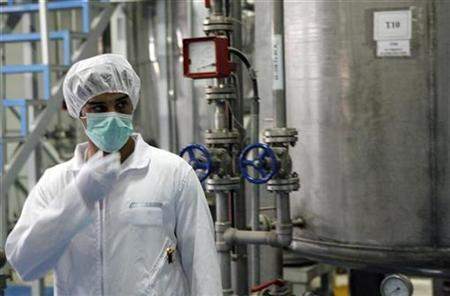 A technician at the uranium conversion facility in Isfahan, south of Tehran, February 3, 2007. Iran's uranium enrichment programme is operating well below capacity and is a long way from producing nuclear fuel in significant amounts, according to a confidential U.N. nuclear watchdog report obtained by Reuters. REUTERS/Caren Firouz