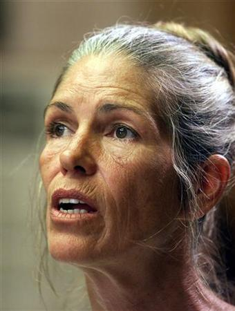 Leslie Van Houten listens during her parole hearing in Corona, California, June 28, 2002. Van Houten, a former follower of serial killer Charles Manson, has been denied parole for the 18th time for the 1969 slayings of Los Angeles couple Leno and Rosemary LaBianca, officials said on Thursday. REUTERS/Damian Dovarganes/POOL