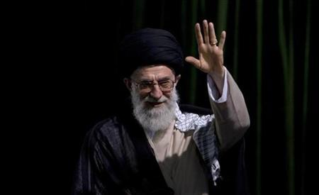 Supreme Leader Ayatollah Ali Khamenei gestures before a ceremony to mark the 18th anniversary of the death of the founder of the Islamic Republic Ayatollah Ruhollah Khomeini at his tomb in the Behesht Zahra cemetery, south of Tehran, June 4, 2007. On Saturday Khamenei replaced the commander of the Revolutionary Guards, a force U.S. officials have said Washington may label a terrorist group. REUTERS/Raheb Homavandi